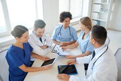 Group of happy doctors meeting at hospital office Royalty Free Stock Image