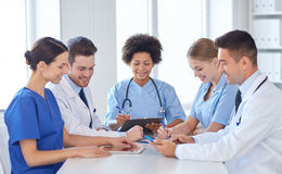 Group of happy doctors meeting at hospital office Stock Image