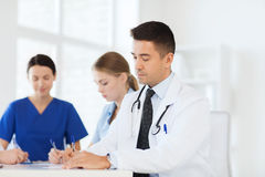Group of happy doctors meeting at hospital office Stock Photos