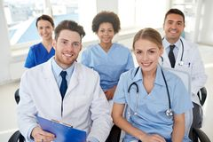 Group of happy doctors on seminar at hospital Stock Photography