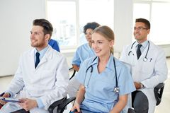 Group of happy doctors on seminar at hospital Royalty Free Stock Images