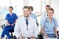 Group of happy doctors on seminar at hospital Stock Images