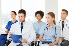 Group of happy doctors on seminar at hospital Royalty Free Stock Photos