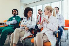 Happy doctors on seminar in lecture hall at hospital stock image