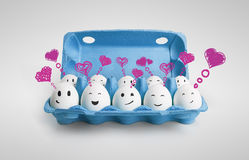 Group of happy eggs with love heart speech bubbles Royalty Free Stock Photo