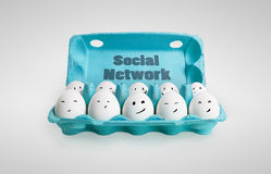Group of happy eggs with smiling faces. Representing a social network. Ten white eggs in a carton box. On a gray background Royalty Free Stock Image