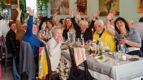 A group of happy elderly. Last year I was traveling in the small town of Maggiore, Italy. I walked into a bar and saw a group of older people at the party. They Stock Photos