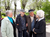 Group of happy elderly people relaxing stock images