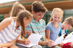 Group of happy elementary school students outdoors Stock Image