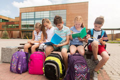 Group of happy elementary school students outdoors. Primary education, friendship, childhood, communication and people concept - group of happy elementary school Stock Images