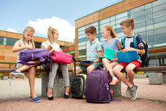 Group of happy elementary school students outdoors Royalty Free Stock Photos