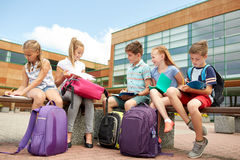 Group of happy elementary school students outdoors Royalty Free Stock Images