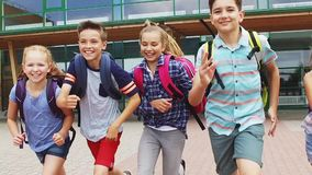 Group of happy elementary school students running stock footage