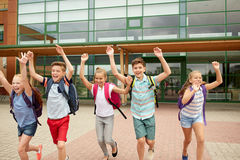 Group of happy elementary school students running Stock Photos