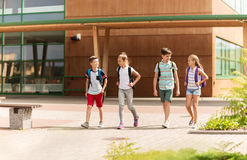 Group of happy elementary school students walking. Primary education, friendship, childhood, communication and people concept - group of happy elementary school Royalty Free Stock Photo