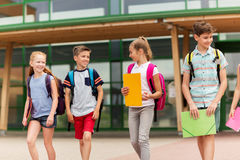 Group of happy elementary school students walking Stock Image