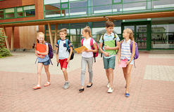 Group of happy elementary school students walking Stock Images