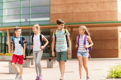 Group of happy elementary school students walking Royalty Free Stock Photos