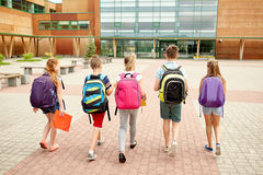 Group of happy elementary school students walking. Primary education, friendship, childhood and people concept - group of happy elementary school students with Stock Photography