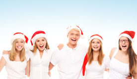 A group of happy and emotional teenagers in Christmas hats Stock Photo