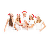 A group of happy and emotional teenagers in Christmas hats Royalty Free Stock Photo