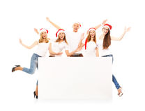 A group of happy and emotional teenagers in Christmas hats Stock Photos