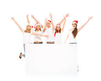 A group of happy and emotional teenagers in Christmas hats Stock Images