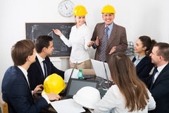 Group of happy engineers discussing project Royalty Free Stock Image