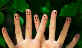 Group of happy finger smileys in nature Royalty Free Stock Photos