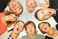 Group of happy friends. Making surprised faces Royalty Free Stock Photo