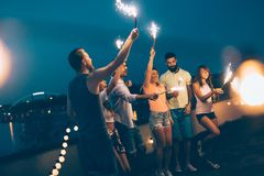 Group of happy friends celebrating at rooftop. Together stock image
