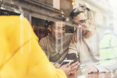 Group of happy friends chatting in the coffee shop. Friendship concept stock photography