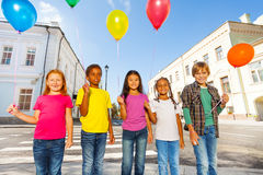 Group of happy friends with colorful balloons Royalty Free Stock Photography
