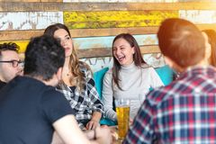 Group of happy friends having fun drinking beer at brewery bar restaurant stock images