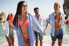 Group of happy friends enjoying the beach at summer. Group of happy friends enjoying the beach with drinks at summer stock image