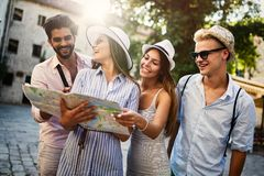 Group of happy friends enjoying sightseeing tour in the city. Happy group of friends enjoying sightseeing tour in the city royalty free stock images