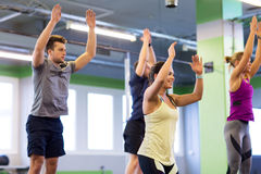 Group of happy friends exercising in gym Stock Image