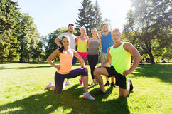 Group of happy friends exercising outdoors Stock Photos