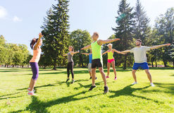 Group of happy friends exercising outdoors Stock Images