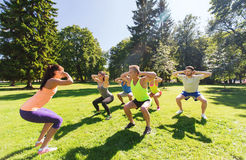 Group of happy friends exercising outdoors Stock Photo