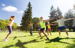 Group of happy friends exercising outdoors Stock Image
