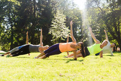 Group of happy friends exercising outdoors Stock Photography