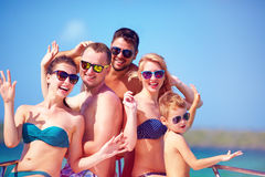 Group of happy friends, family having fun on yacht, during summer vacation Royalty Free Stock Images