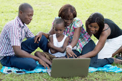 Group of happy friends in front of a laptop. Stock Photography