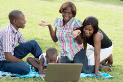 Group of happy friends in front of a laptop. Stock Photos