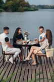 Group of happy friends gathering to having dinner together royalty free stock photo