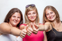 Group of happy friends giving the thumbs up Stock Image