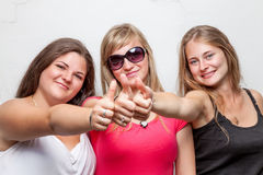 Group of happy friends giving the thumbs up Royalty Free Stock Image
