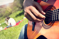 Group of happy friends with guitar having fun outdoor Royalty Free Stock Photos