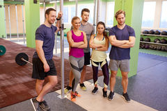 Group of happy friends in gym Royalty Free Stock Photography